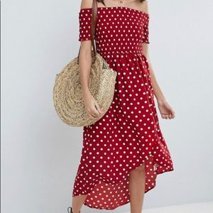 Red polka dot dress with a slit